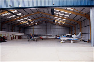 China Easy Expansion Aircraft Hangar Buildings With Minimal Material Loss supplier
