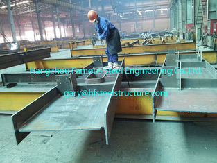 China Pre Engineering Commercial Steel Buildings H Section Beam Coated Grey Painting supplier