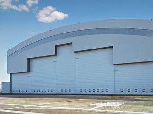 China Prefab Curve Roofing System Steel Aircraft Hangars With Electrical Slide Doors supplier